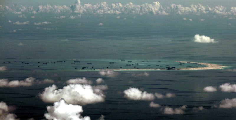 Beijing officially landed military plane on the South China Sea reef