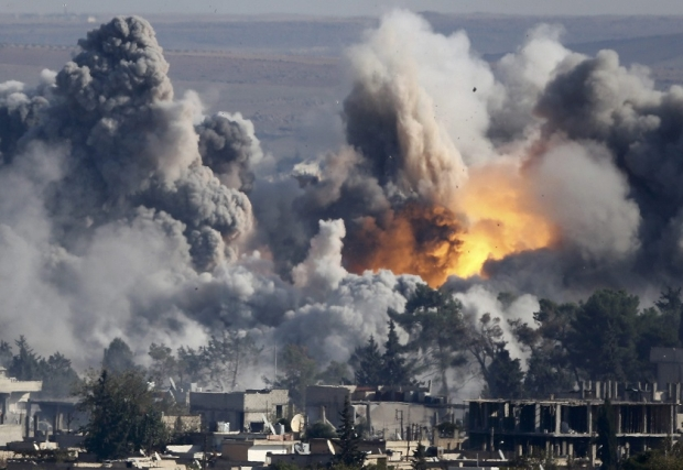 US-led Coalition Conducted 150 Air Strikes against ISIS in Syria's Northern Raqqa
