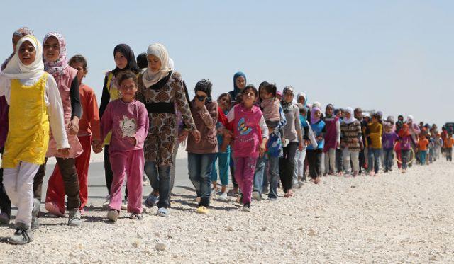Turkey Blackmails EU with Refugee Deal