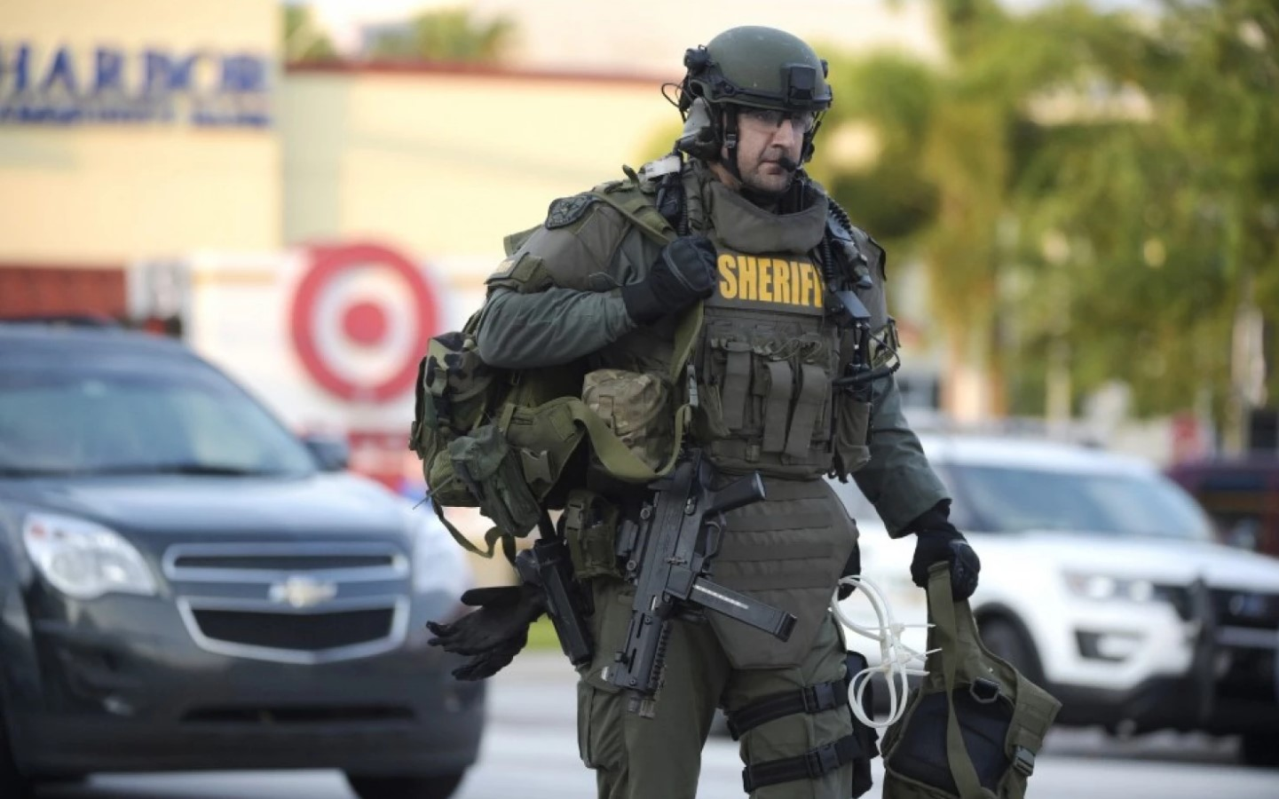 An Orange County Sheriff's Department SWAT member arrives to the scene of a fatal shooting at Pulse nightclub in Orlando on June 12. (Phelan M. Ebenhack/AP)