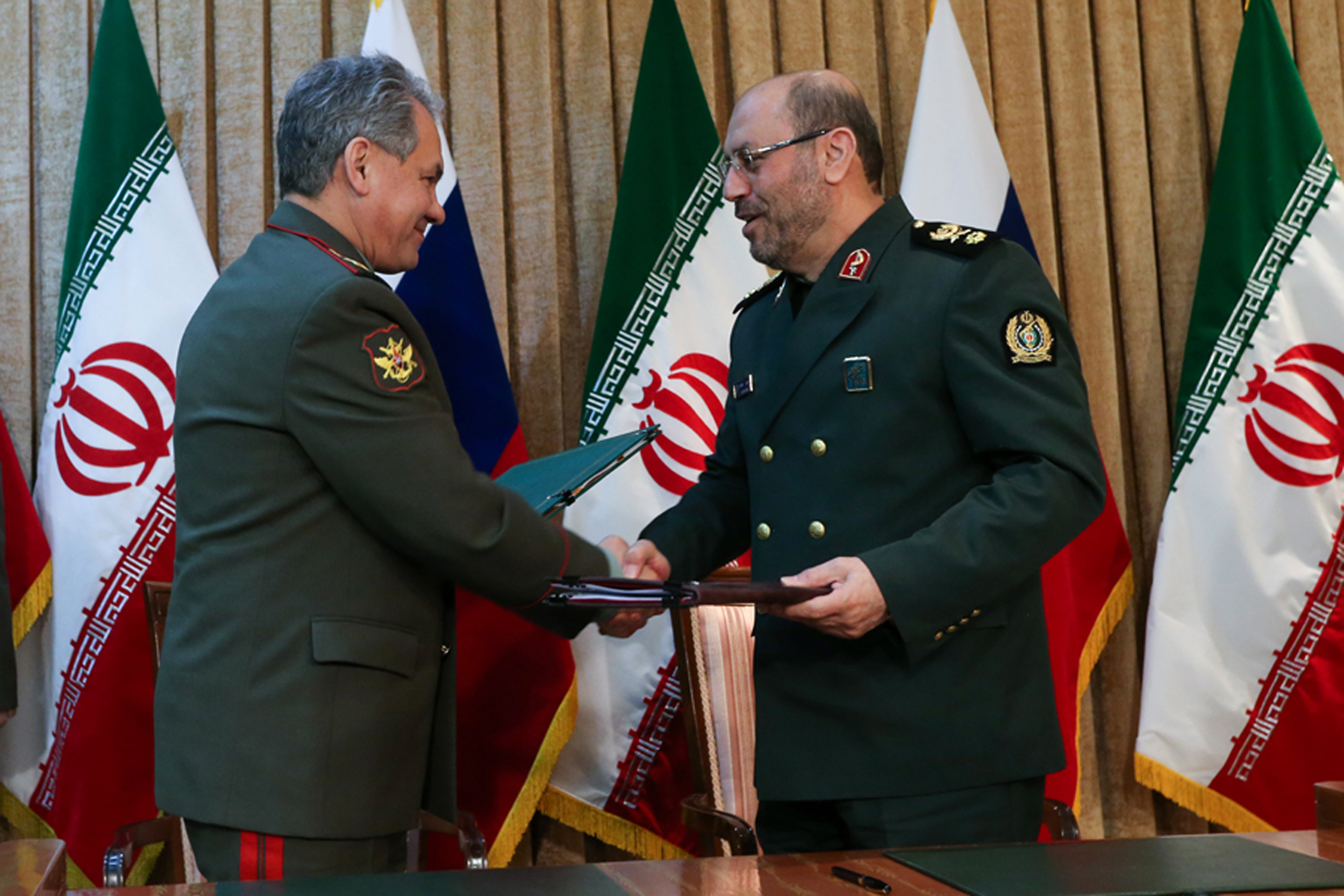 Jan. 20, 2015 Russia's Defense Minister Sergei Shoigu, left, and Iran's Defense Minister Hossein Dehghan  (AP Photo/ Vadim Savitsky, Russian Defense Ministry Press Service)