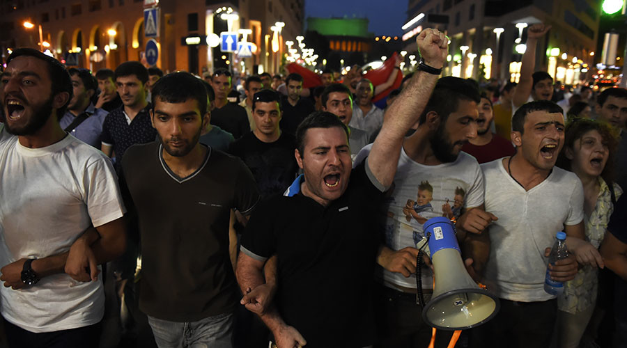 Protesters Clash with Police in Yerevan During the Ongoing Hostage Situation