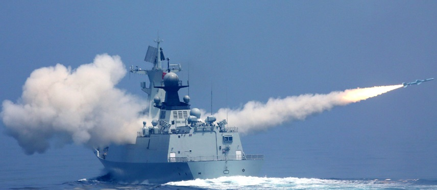 A Chinese PLAN Type 054 FFG fires a YJ-83 anti-ship missile.