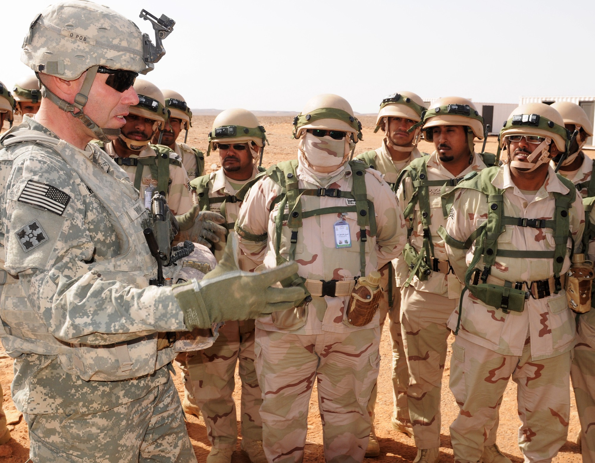 An American soldier talks with Saudi troops. Army photo