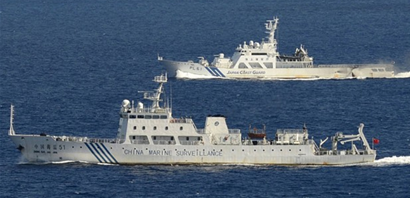 A Japan Coast Guard Cutter confronting a China Marine Surveillance vessel within the territorial waters of the Senkaku Islands. Such incidents have increased in recent weeks.
