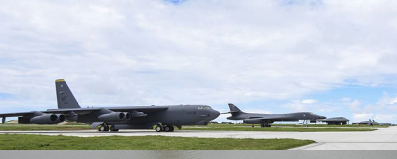 B-52, B-1 and B-2 bombers all parked on the tarmac at Andersen Air Force Base on the island of Guam.