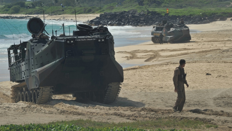 Japanese troops from the Western Army Infantry Regiment train with U.S. Marines in Hawaii in conducting amphibious assault with AAV7s, August of 2014.