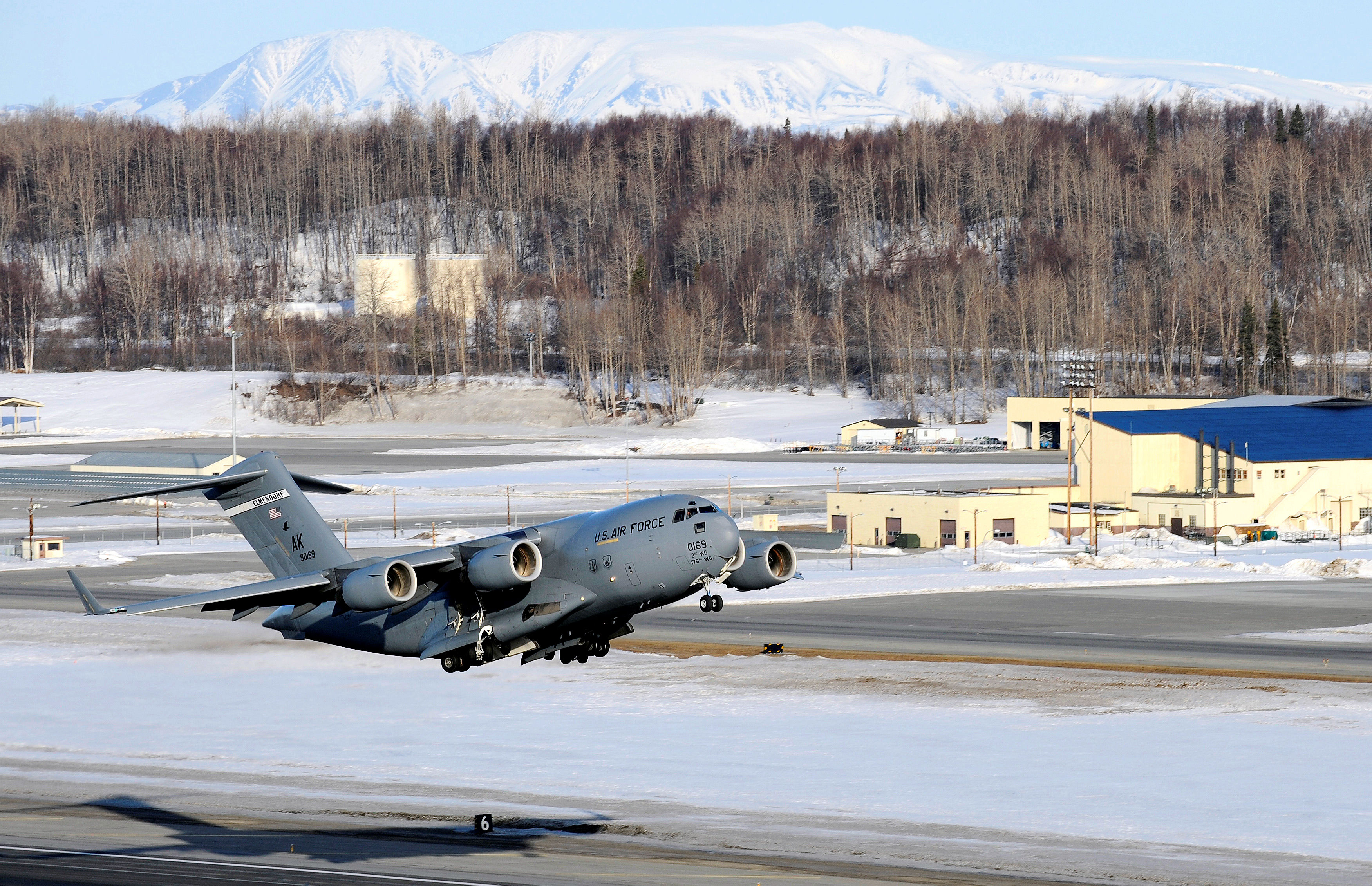 A C-17 Globemaster III takes off from Elmendorf Air Force Base March 26.  Col. Thomas Bergeson, 3rd Wing commander and F-22 Raptor pilot, was behind the controls of the aircraft for the first time. The flight included a KC-135 Stratotanker refuel, tactical arrivals and departures at Allen Army Air Field and low-level flying.  (U.S. Air Force photo/Staff. Sgt. Brian Ferguson)