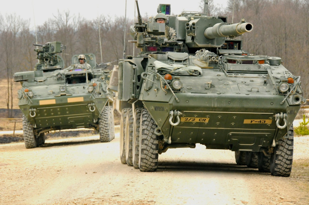 M1128 MGS armed with a 105mm gun accompanies a M1126 Infantry Carrier Vehicle (ICV).