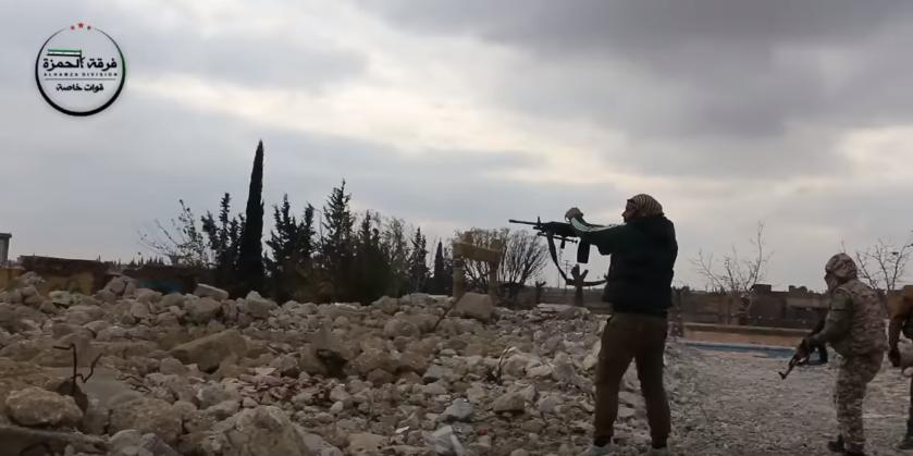 A FSA militant poses for a photo-report of the FSA's battle against ISIS""