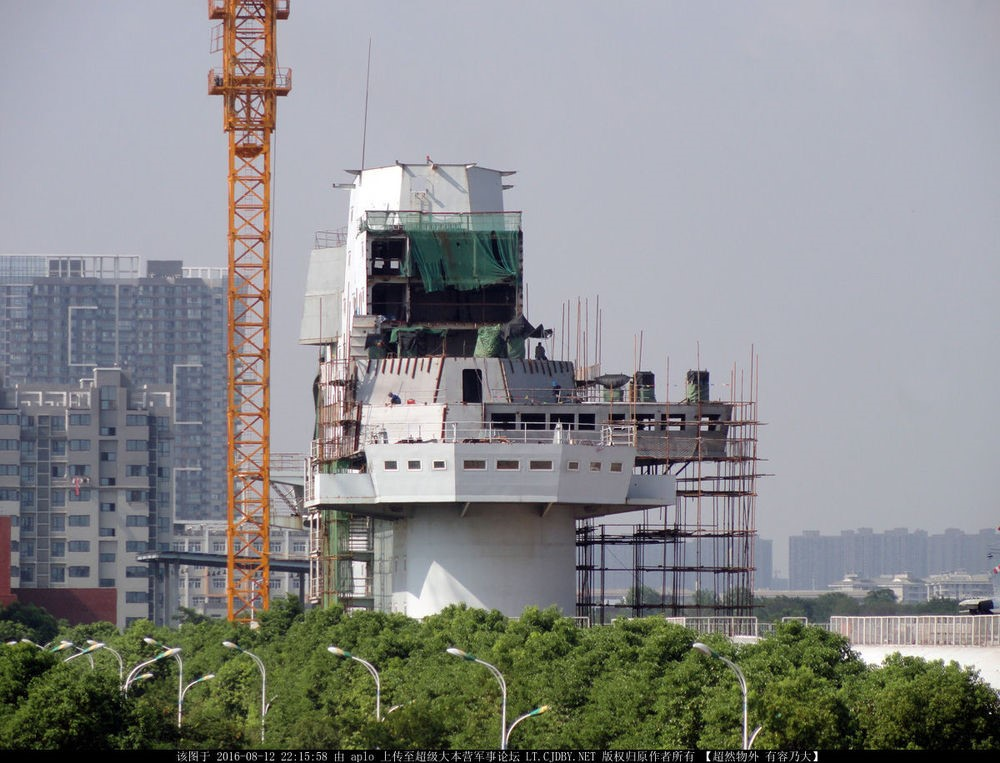 The aircraft carrier bridge orientation and training mock-up in Wuhan, China is being extensively modified to mirror the new island design of the CV-17 still under construction.