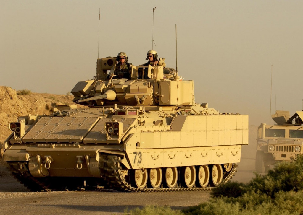 M2A3 BUSK in Iraq. Note the addition of Explosive Reactive Armor on the hull and turret and the additional skirting.