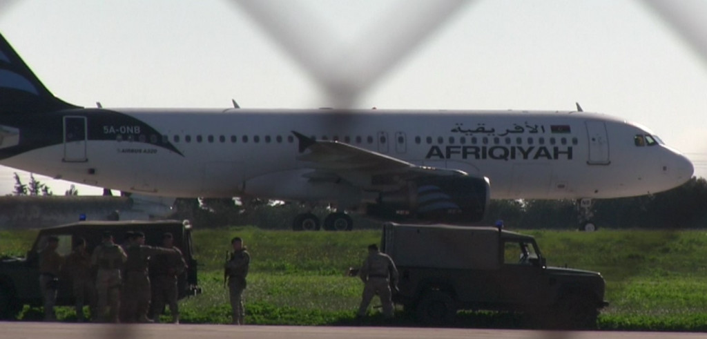 Hijacked Libyan plane lands in Malta; hijacker claiming to be in possession of a hand grenade