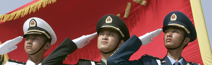 (L to R) Honour guards from the navy, land, and air force of the People's Liberation Army dress in the latest uniform and salute in formation in Beijing August 1, 2007. China called its growing military strength a force for peace and Communist Party rule on the 80th anniversary of the PLA on Wednesday, even while a senior commander warned Taiwan not to risk war. REUTERS/Joe Chan (CHINA)