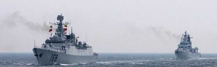 Chinese Navy warships attend an international fleet review to celebrate the 60th anniversary of the founding of the People's Liberation Army Navy on April 23, 2009 off Qingdao in Shandong Province.  Fifty-six Chinese subs, destroyers, frigates, missile boats and planes were displayed off the eastern port city of Qingdao just weeks after tensions flared following a naval stand-off with the United States in the South China Sea.  AFP PHOTO / POOL / Guang Niu / AFP PHOTO / POOL / GUANG NIU