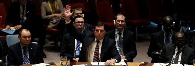 Russian Deputy Ambassador to the United Nations Vladimir Safronkov raises his hand to vote against a UN Security Council resolution to ban the supply of helicopters to the Syrian government and to blacklist Syrian military commanders over alleged chemical attacks at UN headquarters in New York City, US, February 28, 2017. (Photo by Reuters)