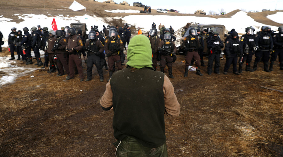 Police & military clear DAPL protest camp, dozens arrested, protesters start fires (Photo & Video)
