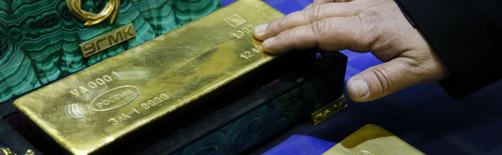 An employee displays a gold bar at a gold refining workshop of the plant of Uralelektromed Joint Stock Company (JSC), the enterprise of Ural Mining and Metallurgical company (UMMC) in the town of Verkhnyaya Pyshma, outside Yekaterinburg, Oct. 17.