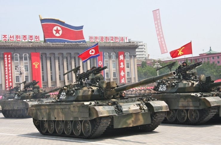 Pokpung-ho III MBTs on parade in Pyongyang. Note the provision of a MANPAD and two ATGMs on the top of the turret. The addition of armor to the T-62 hull and turret front are clearly visible.