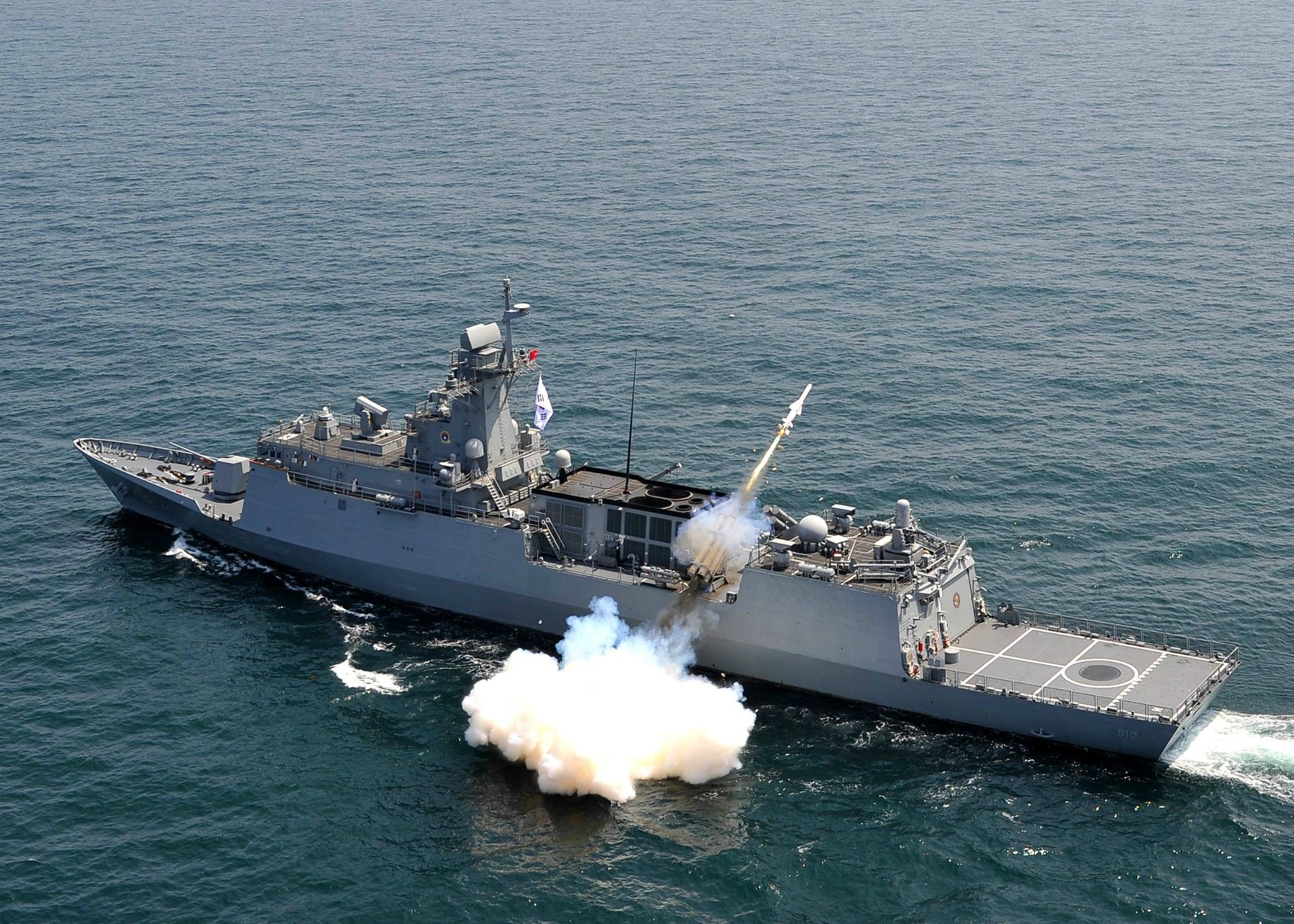 Incheon Class frigate firing a Hae Sung (Sea Star) SSM-700K anti-ship missile from its port side quad launcher.