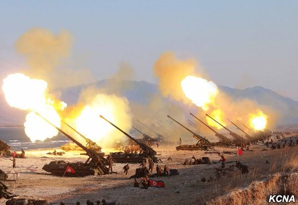Koksan M-1989 heavy artillery batteries conducting live fire exercises on the western coast of North Korea.
