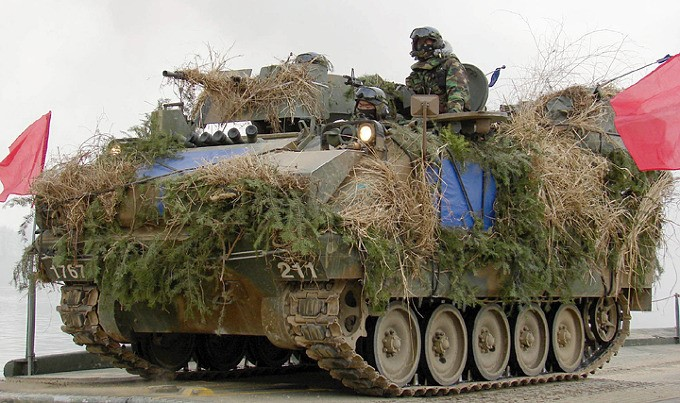 Heavily camouflaged K-200 APC during a winter military exercise.
