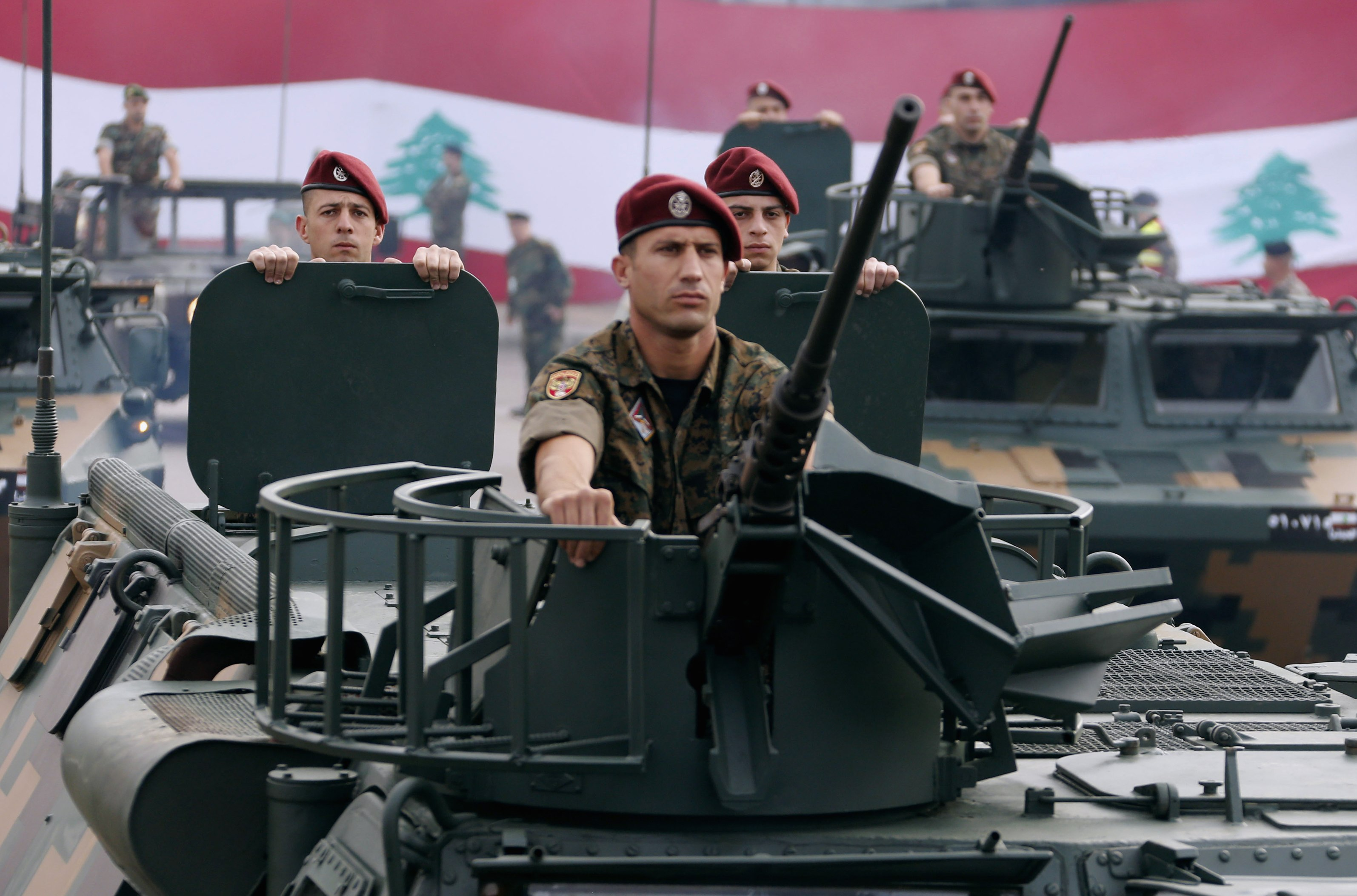 Lebanese Army soldiers on their military vehicles take part in a military parade to celebrate the 70th anniversary of Lebanon's independence, in downtown Beirut November 22, 2013. REUTERS/Mohamed Azakir (LEBANON - Tags: ANNIVERSARY POLITICS MILITARY)