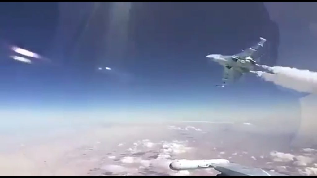 Crazy Cockpit Video: Russian Warplane Buzzes Another At High Altitude