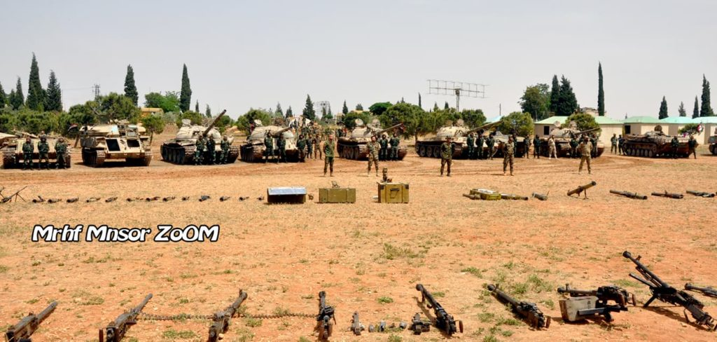 Militants, Their Supporters Start Leaving Rastan Pocket Under Deal With Government (More Photos Of Weapons)