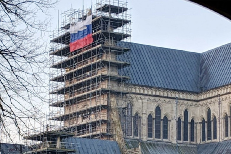 Propaganda War: Russian Flag Flies On Scaffolding At Salisbury Cathedral. Facebook Bans RT's In The NOW