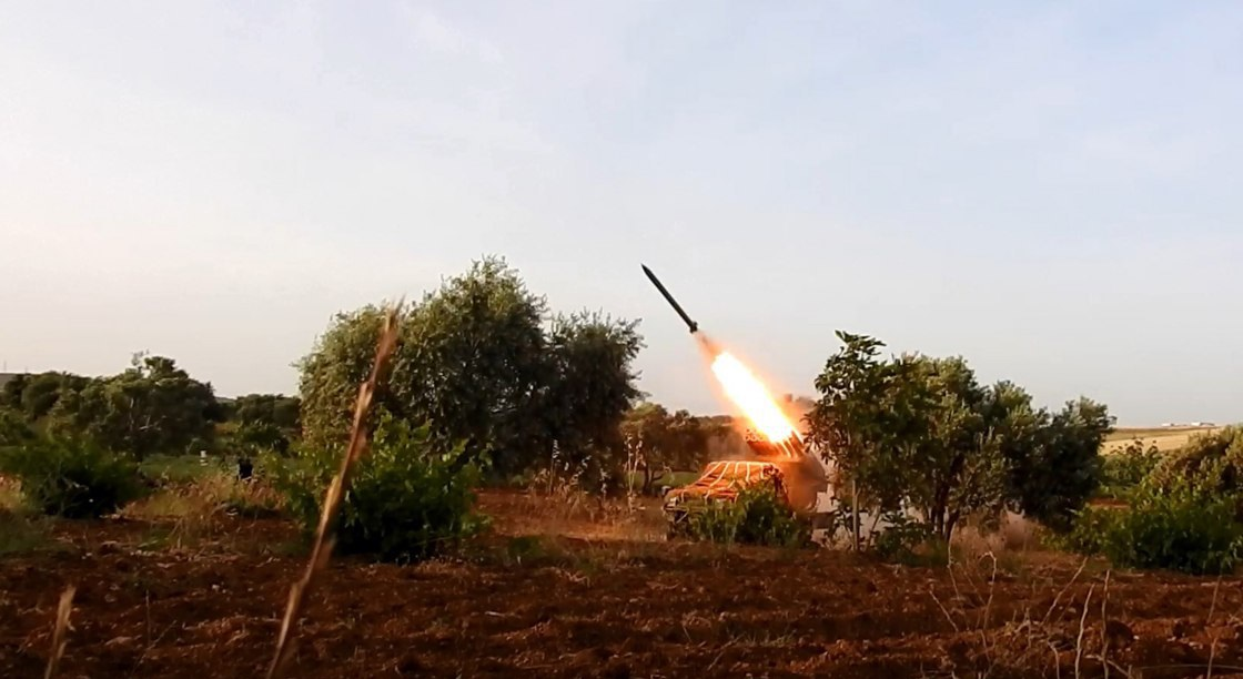 Hay'at Tahrir Al-Sham Shells Hama Airbase With Barrage Of Rockets