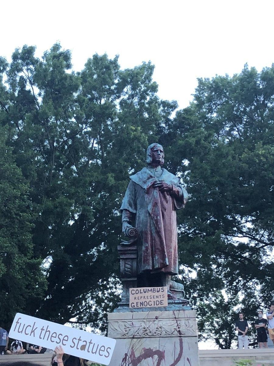 U.S. Protesters Deface, Set On Fire, And Throw Columbus Statue In A Lake For Being Racist