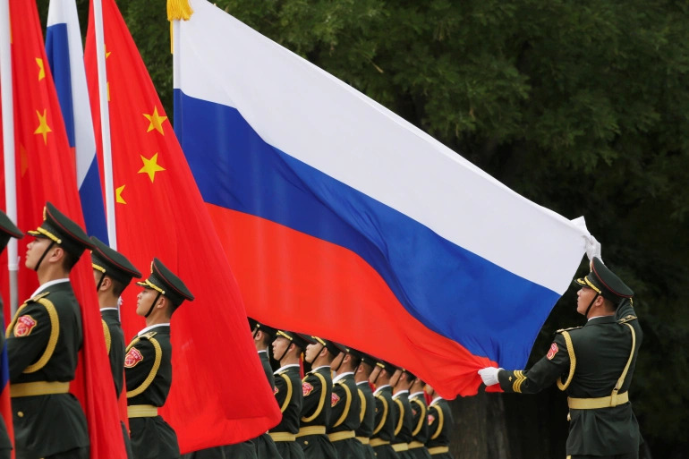 Russia And China Hold Large-Scale Military Exercises In Face Of Mounting Pressure On Beijing