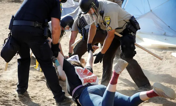 Private Democracy: Canadian Company Paid U.S. Police To Arrest And Spy On Protesters So It Completes Pipeline